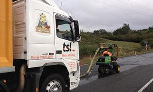 TSL truck behind waterblasting equipment