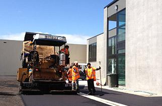 TSL crew laying asphalt at jobsite